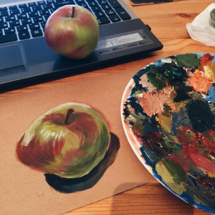 Apple painted on cardboard
